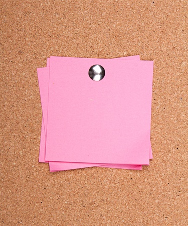 pin board: pink sticky note on a bulletin board with push pin Stock Photo