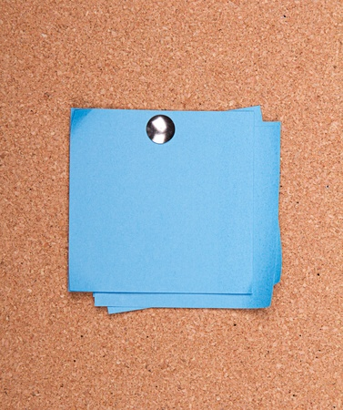 paper pin: blue sticky note on a bulletin board with push pin