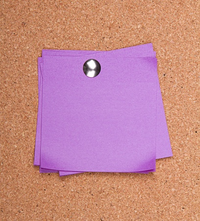 pin board: Purple sticky note on bulletin board with push pin Stock Photo