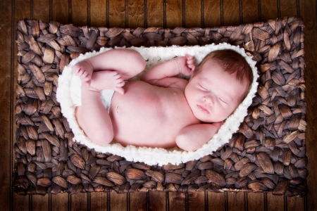 Newborn infant baby laying in a basket