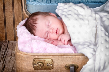 Newborn infant baby sleeping in suitcase Stock Photo - 18163023