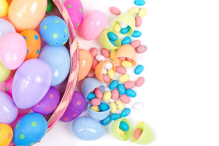 Plastic Easter Eggs Filled With Candy In A Basket On White Background Photo