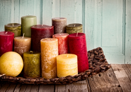collection of decoratice candles on a rustic antique wooden background Stock Photo