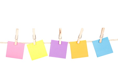 Sticky notes on a clothes line on an isolated white background