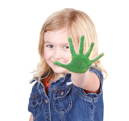A child with green paint on her hand isolated on a white background photo