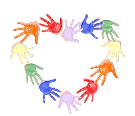 Painted hands forming a heart shape, isolated on white background photo