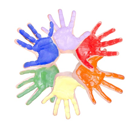 Painted hands in a circle, rainbow colors isolated on white photo
