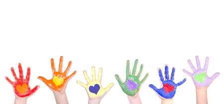 Childrens hands painted in rainbow colors for a border isolated on white background Foto de archivo