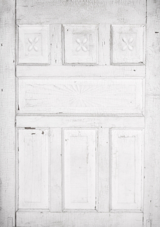 Antique white cracked wooden door panel with architecture detail Banco de Imagens