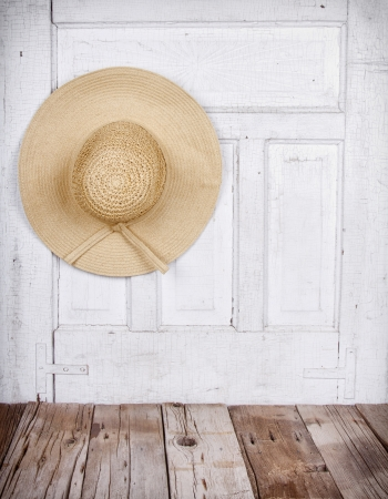 head wear: Sun or Straw hat on antique wooden background Stock Photo