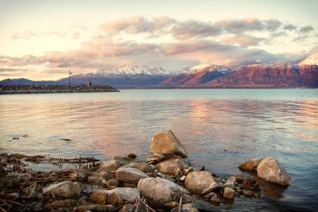 Utah lake with Timpanogos mountains in the background, taken in Saratoga Springs Utah at sunset