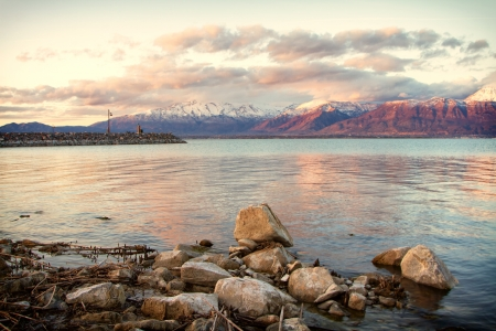 Utah lake with Timpanogos mountains in the background, taken in Saratoga Springs Utah at sunset