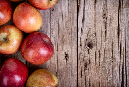 Apples on rustic wooden plank