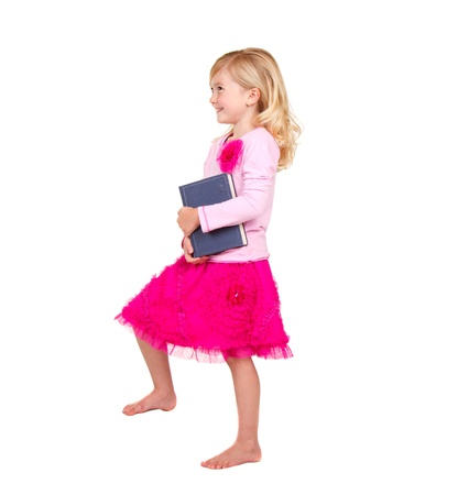stepping: child or girl holding book stepping up isolated on white