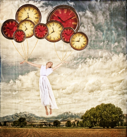 out time: Woman tied to clocks floating away on an antique or grunge background, time concept Stock Photo