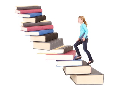 pre teen girls: child or girl climbing a staircase of books, isolated on white
