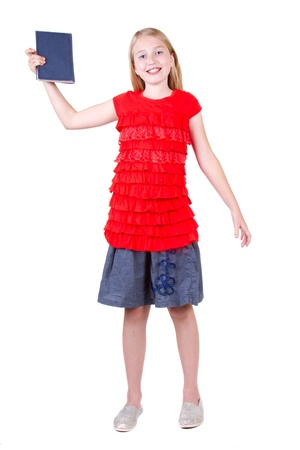 pre adolescents: teen holding a book above head, isolated on a white background