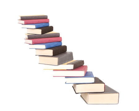 a stair case of books isolated on a white background Stock Photo - 20984553