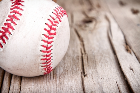 stitching: Close-up of baseball on rustic wooden background