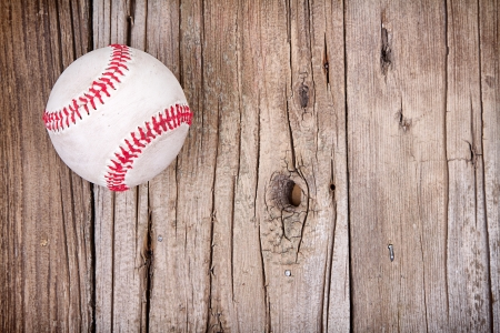 Baseball on rustic wooden background photo