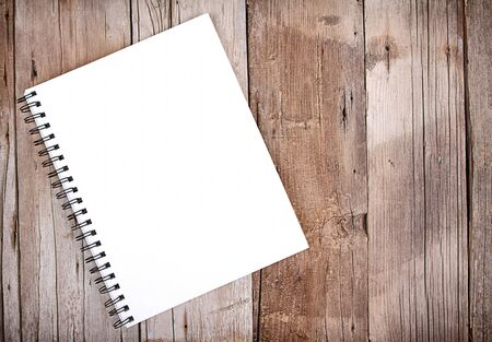 notebook: Blank sketch book or notebook on wooden plank for background