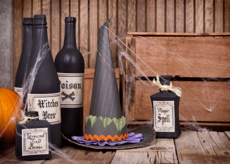 Potion bottles and witches hats with pumpkins and gourds on wooden planks photo