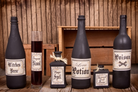 Potion bottles on rustic wooden planks photo