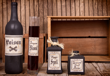 witch spider: Potion bottles on rustic wooden planks