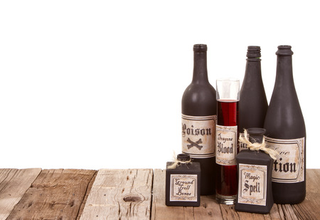 Potion bottles on wooden crates, isolated on a white background photo
