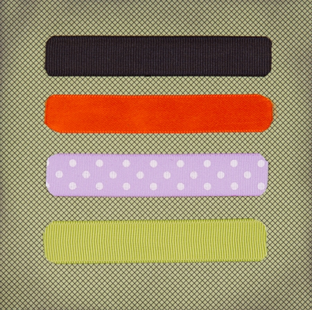 colored paper: Halloween colored ribbon tags on a scrapbook paper background