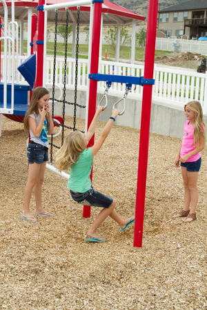 Children or teens playing at playground outside