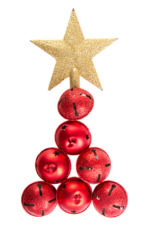 Christmas jingle bells and golden star shaped like a Christmas tree on an isolated white background Stock Photo