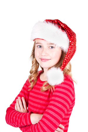 Child or teen girl wearing a Santa hat on an isolated white background photo