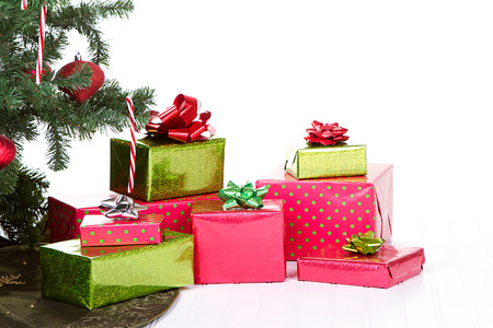 under tree: Christmas presents under a Christmas tree with an isolated white background