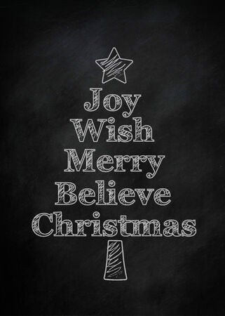 A black chalkboard with Christmas writing on it in the shape of a Christmas tree photo