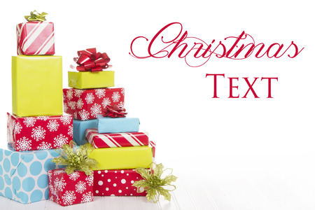 A stack of Christmas presents with an isolated white background