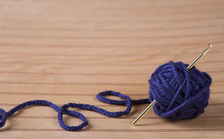 skein: Ball of blue yarn with crochet needle