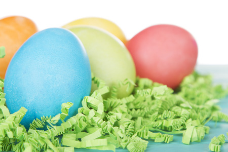 colored backgound: Dyed Easter eggs on green confetti grass
