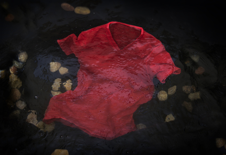 dreary: Red t-shirt floating or sinking in water
