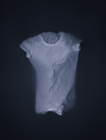 mens shirt: White t-shirt floating or sinking in water Stock Photo