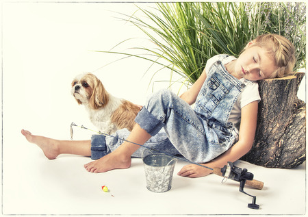 painterly: Child or young girl with her dog taking a nap or sleeping while fishing, painterly style with vintage filter applied. Stock Photo