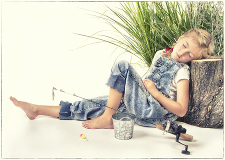 painterly: Child or young girl taking a nap or sleeping while fishing, painterly style with vintage filter applied. Stock Photo
