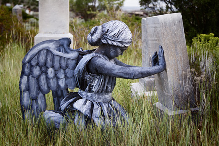 angel cemetery: Girl wearing a home made life like angel costume in an old grave yard