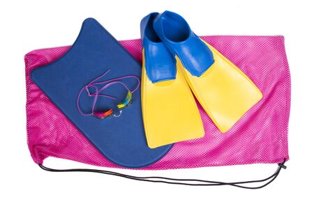 swim: Swim fins, kick board and goggles on a pink swim bag, isolated white background for high school swim team background or competitive swim teams.