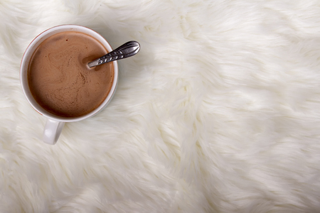 A mug of hot chocolate or cocoa on a faux fur background