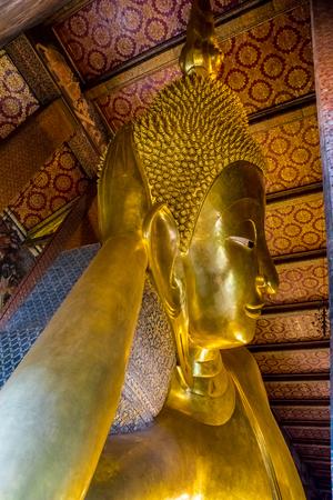 reclining: RECLINING BUDDHA AT WAT PO BANGKOK THAILAND Stock Photo