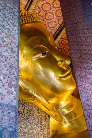 recline: RECLINING BUDDHA AT WAT PO BANGKOK THAILAND Stock Photo
