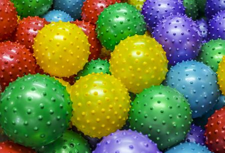 spiked: A bunch of vibrant colored balls in a carnival machine or ball pit