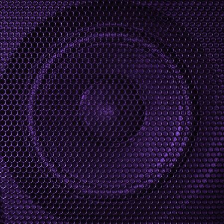A close up macro photo of a speaker lit with a vibrant purple flash gel