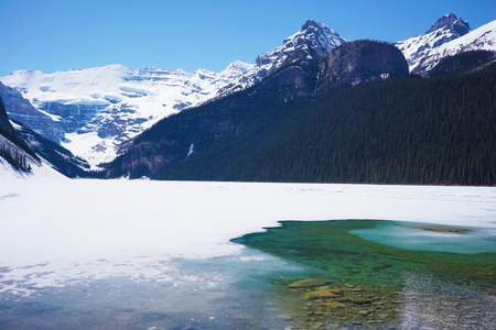 Frozen Lake Louise in snowy Rocky Mountains
